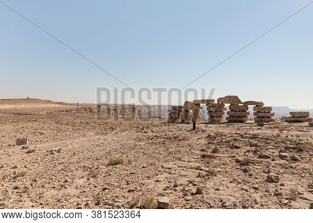 Large Boulders Stacked Figuratively On Top Of One Another In A Public Sculpture Park In The Desert,