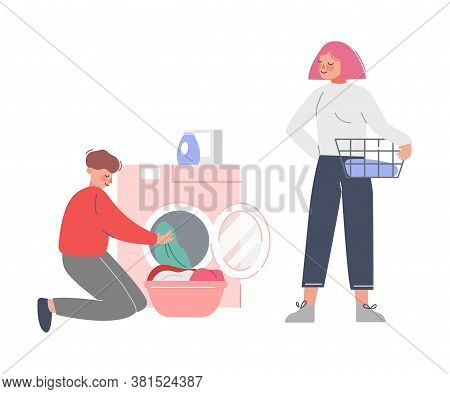 Young Man And Woman Doing Laundry At Home Or Public Laundrette, Guy Putting Dirty Clothes In Washing