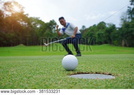 Blurred Golfer Playing Golf In The Evening Golf Course, On Sun Set Evening Time. Man Playing Golf On