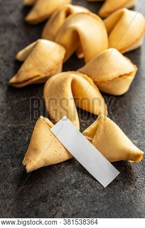 Chinese lucky cookies. Fortune cookies on black table.