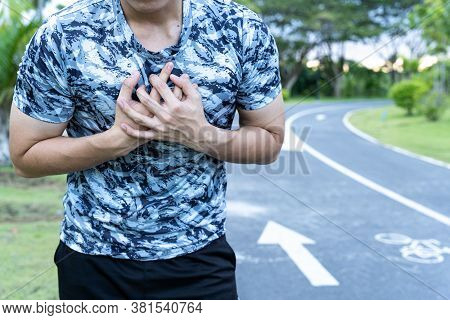 Exhausted Male Runner Suffering Painful Angina Pectoris Or Asthma Breathing Problems After Running A