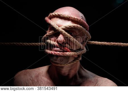 Photo Of Binded Adult Man With Rope On Face