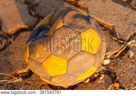 Brasilia, Brazil-july 30, 2020: A Worn Out Children's Soccer Ball Found In A Parking Lot