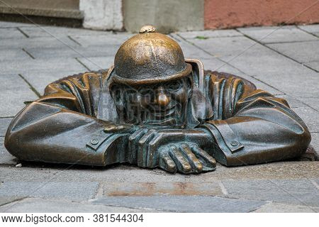 Bratislava, Slovakia - July 5th 2020: The 'man At Work' Statue Called Cumil, In Bratislava's Old Tow