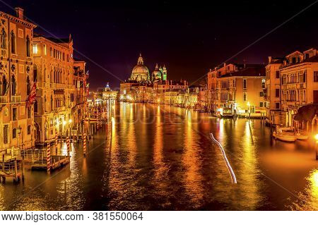 Colorful Grand Canal And Santa Maria Della Salute Church At Night With Reflections In Venice Italy C