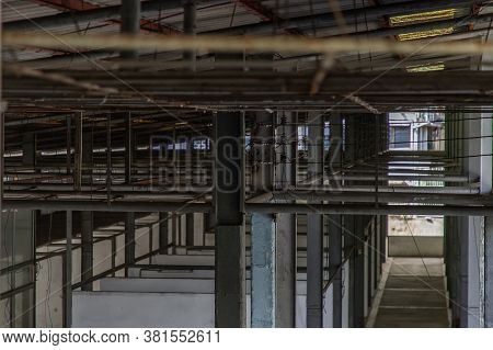 The Structure Inside The Warehouse With Light Pole. Old Structure In Old Building Indoor. No Focus,
