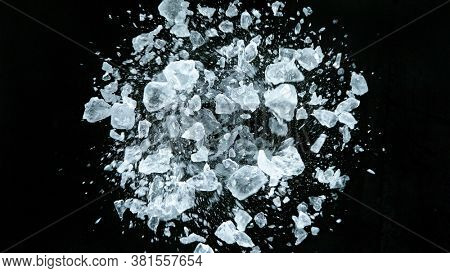 Crushed ice in motion, isolated on black background.