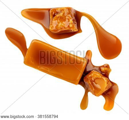 Caramel Candies With Caramel Sauce Isolated On A White Background Close Up. Melted Sweet  Toffee Top