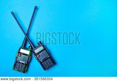 Two Walkie-talkie Radio On Blue Background, Top View