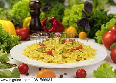 Plate Of Italian Pasta, Farfalle With Tomatoes And Basil