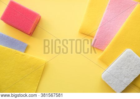 Multicolored Cleaning Micro Fiber Cloth And Cleaning Sponges Isolated On Yellow Background. Home Cle