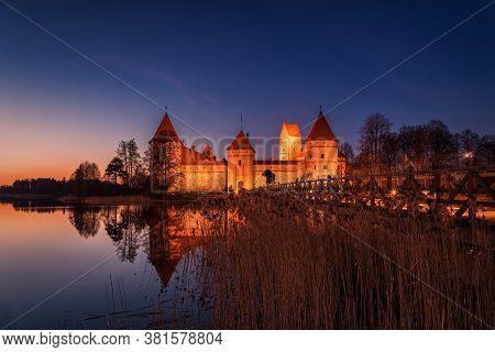 Lithuania, Trakai . Trakai Castle At Night - Island Castle In Trakai Is A Museum And A Cultural Cent