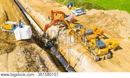 Tachov / Czech Republic - August 18, 2020: Construction site of Antelope gas pipeline. One part of Nord Stream 2 pipeline from Russia to European Union. Workers and cranes making new way for gas.