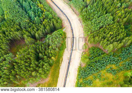 Construction site of gas pipeline in deep forest. Devastated landscape in natural park Slavkovsky les in Western Bohemia. Czech Republic, European Union.