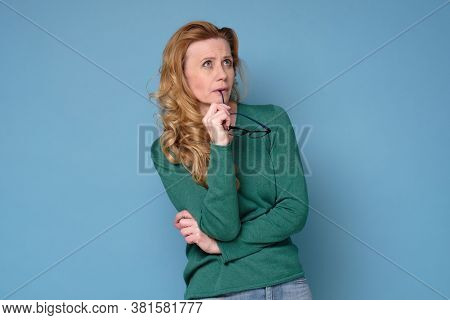 Mid Adult Woman Contemplating Looking Aside Planning.