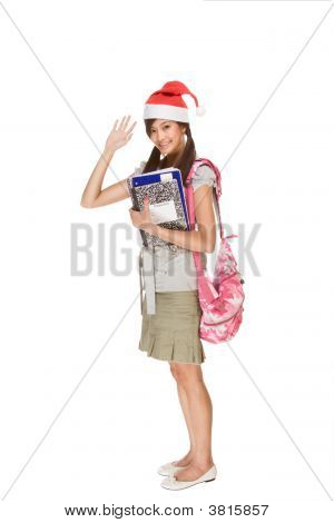 Asian Student In Christmas Hat Gesturing Greets