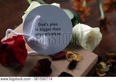 Inspirational Motivational Quote - God Plans Is Bigger Than Your Mistakes. Note Message Written On P