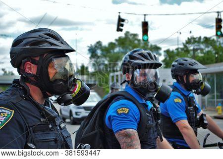 Dayton, Ohio United States 05/30/2020 Police Officers Putting On Gas Masks Preparing To Deploy Oc Pe