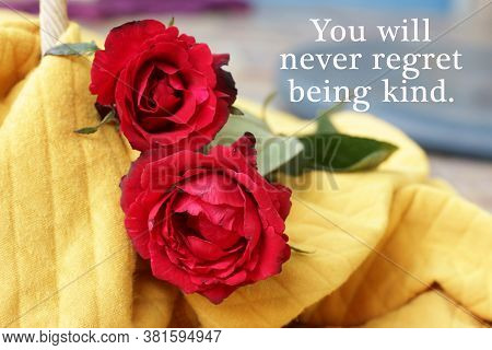 Inspirational Motivational Quote - You Will Never Regret Being Kind. Kindness Concept With Red Roses