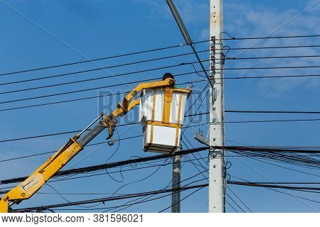 Electricians Wiring Cable Repair Services,worker In Crane Truck Bucket Fixes High Voltage Power Tran