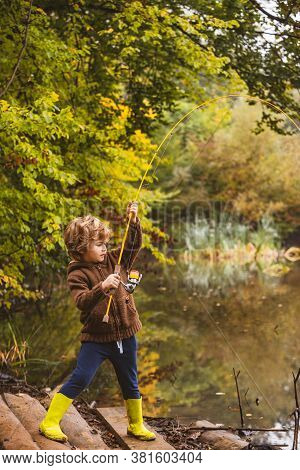 Photo Of Kid Pulling Rod While Fishing On Weekend