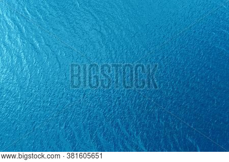 Aerial View Of A Crystal Clear Sea Water Texture. View From Above Natural Blue Background. Blue Wate
