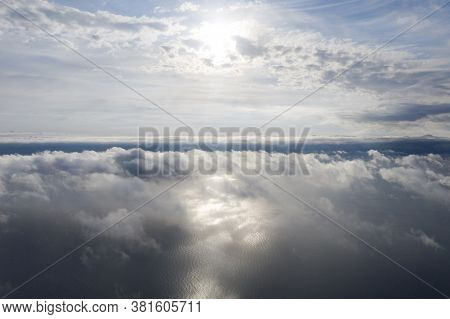 Aerial View Clouds Over The Sea. View From Drone. Aerial Top View Cloudscape. Texture Of Clouds. Vie