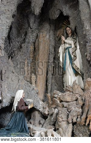 NOVALJA, CROATIA - SEPTEMBER 29, 2013: Altar of Our Lady of Lourdes, altar in the parish church of St. Catherine of Alexandria in Novalja, Croatia