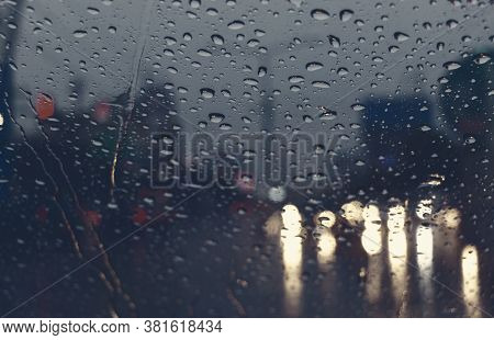 Raindrops On Windshield At Night In Bad Weather Condition