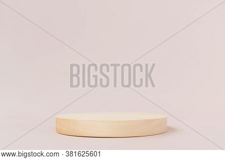 Wooden Textured Round Low Podium On A Light Background. Background For Product Photography, Organic