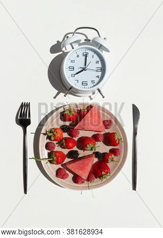 Intermittent Fasting Concept With Empty Colorful Plates. On Plate Are Berries, Strawberries, Raspber