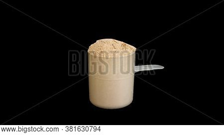 The Whey Protein On A Black Background.