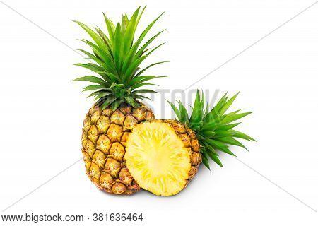 Whole Pineapple And Pineapple Slice. Pineapple With Leaves Isolate On White. Full Depth Of Field. Su