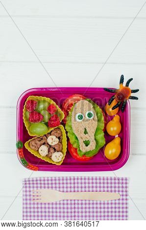Halloween Lunch Box With School Lunch On White Wooden Background