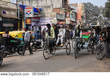 Varanasi, India - Dec 24, 2019: People In The Crowded Streets Of Varanasi. Traffic Scene
