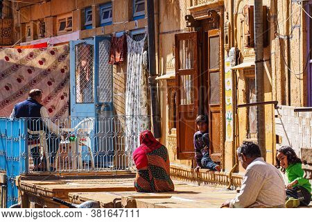 Jaisalmer, India - Dec 31, 2019: Indian Rajasthani People In National Clothes In The Streets Of Jais