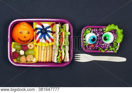 Open Halloween Lunch Box With School Lunch On Black Background