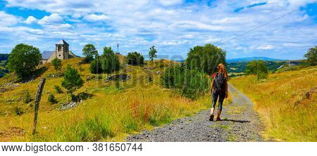 woman hiking on road in France countryside