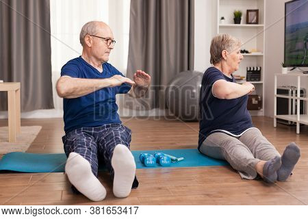 Active Senior Couple Stretching Their Bodies. Old Person Healthy Lifestyle Exercise At Home, Workout