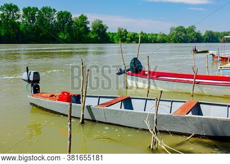 Fishing Boats Are Anchored On Improvised Dock On The River.