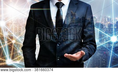 Double Exposure, Business Man Holding Something Imaginary On Palm Of His Hand At City Night Backgrou