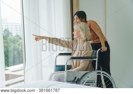 Happy Senior Mother And Grow Daughter Talk At Home.  Family Of Diverse Skin. Concept Of Love Sharing