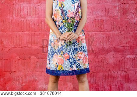 Woman Holding Wildflowers. Happy People Lifestyle. Woman Holding Wildflowers On Red Background. Natu