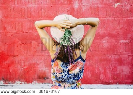 Beautiful Woman Holding Wildflowers. Happy People Lifestyle.woman Holding Wildflowers On Red Backgro