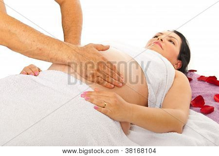 Therapist Massaging Pregnant Belly
