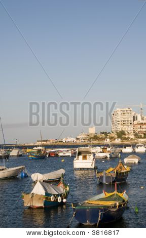 luzzu fishing boats in malta harbor sliema poster
