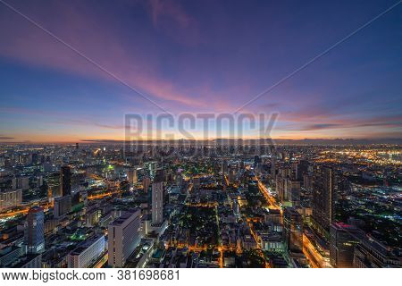 Aerial View Of Bangkok Downtown Skyline With Fog. Thailand. Financial District And Business Centers