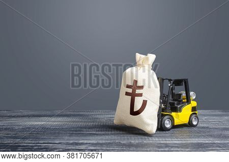 Forklift Transports A Turkish Lira Money Bag. Attraction Of Large Investments In Business And Econom