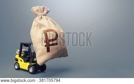 Forklift Carrying A Russian Ruble Money Bag. Strongest Financial Assistance, Business Support. Anti-