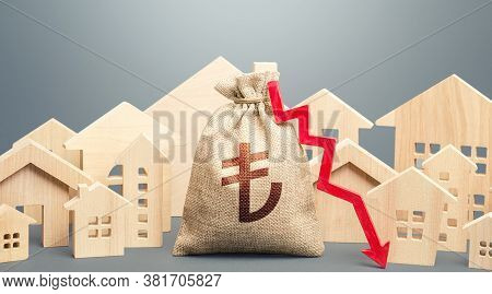 City Residential Buildings And Turkish Lira Money Bag With A Red Down Arrow. Low Demand For Home Buy
